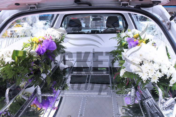 Flower decoration in funeral hearse
